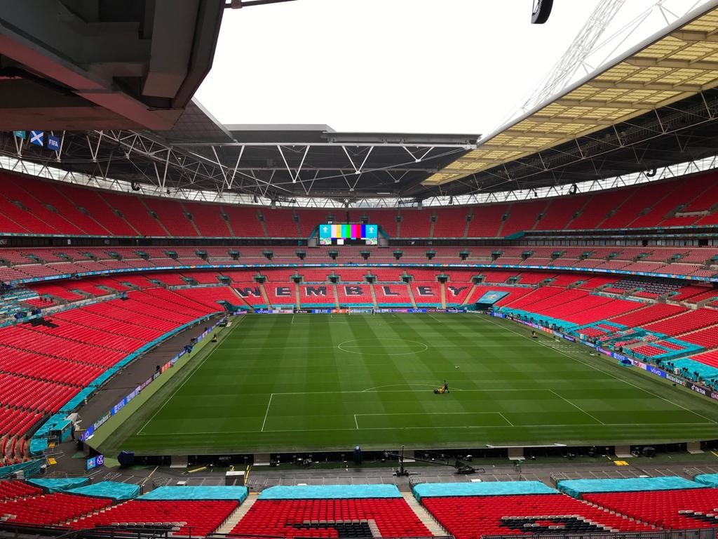View of Wembley stadium pitch from the rafters.