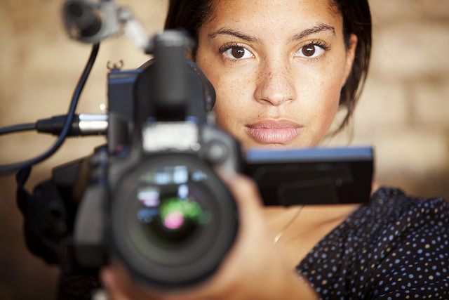 Woman Behind Film Camera