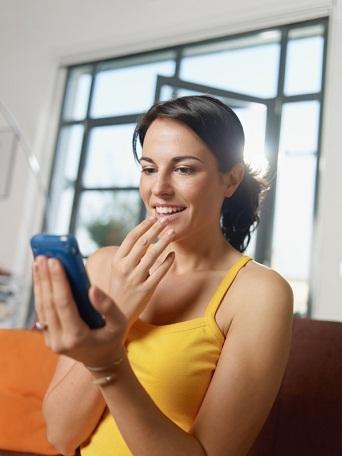 Woman looking at smartphone screen