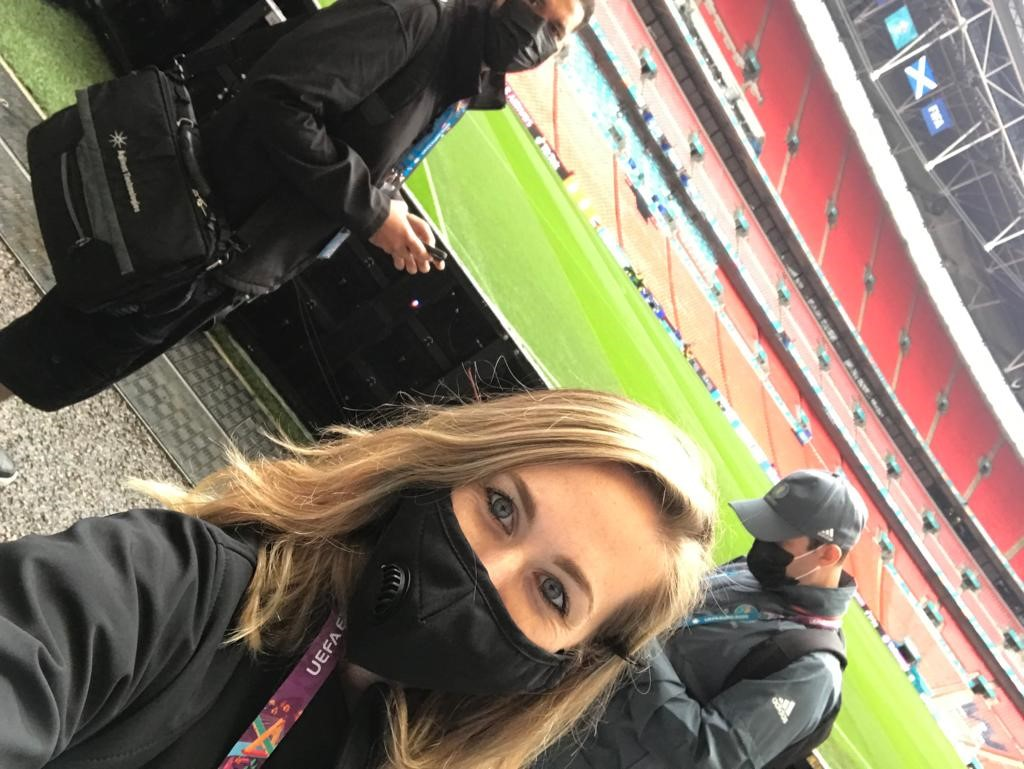 Photo of Janelle at pitchside.