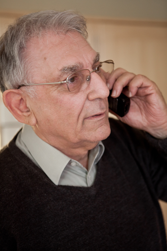 Older man answering phone