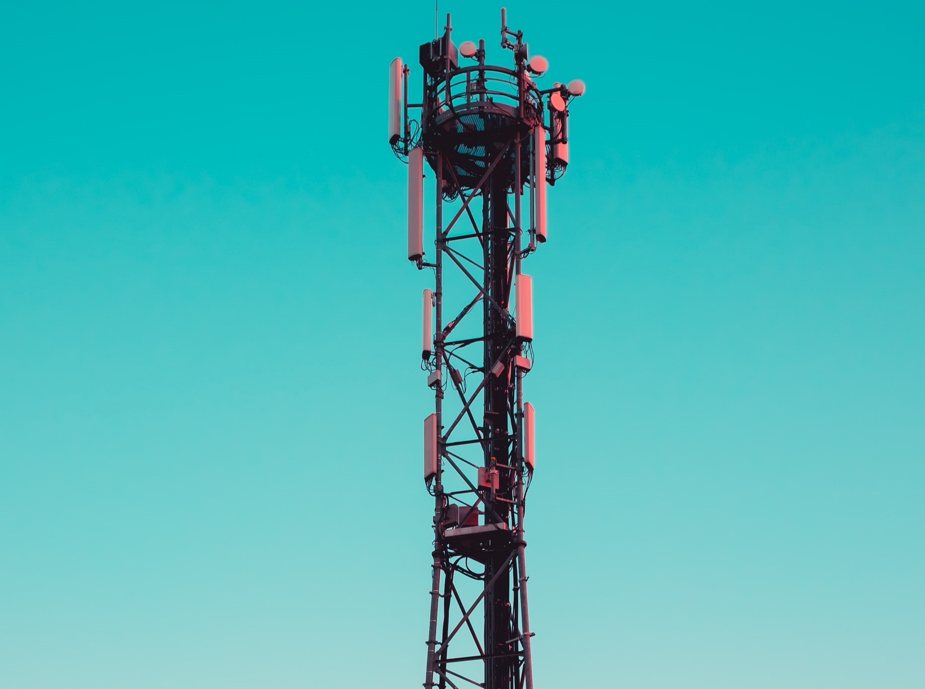 mobile mast against bright blue backdrop