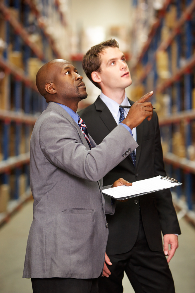 Staff looking at stock in a warehouse