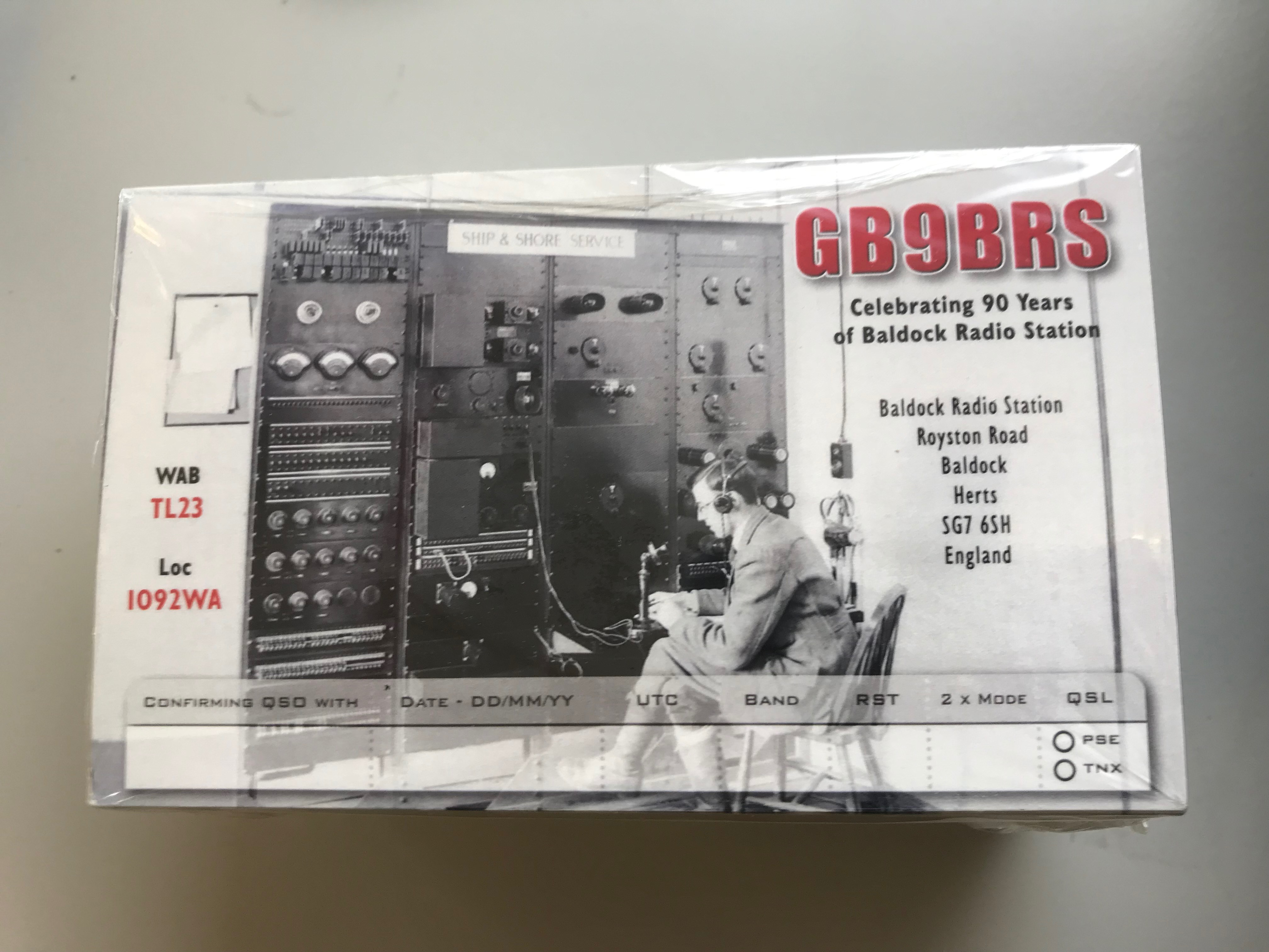 Close-up photo shows the 90th anniversary QSL card, with the description 'Celebrating 90 years of Baldock Radio Station'.