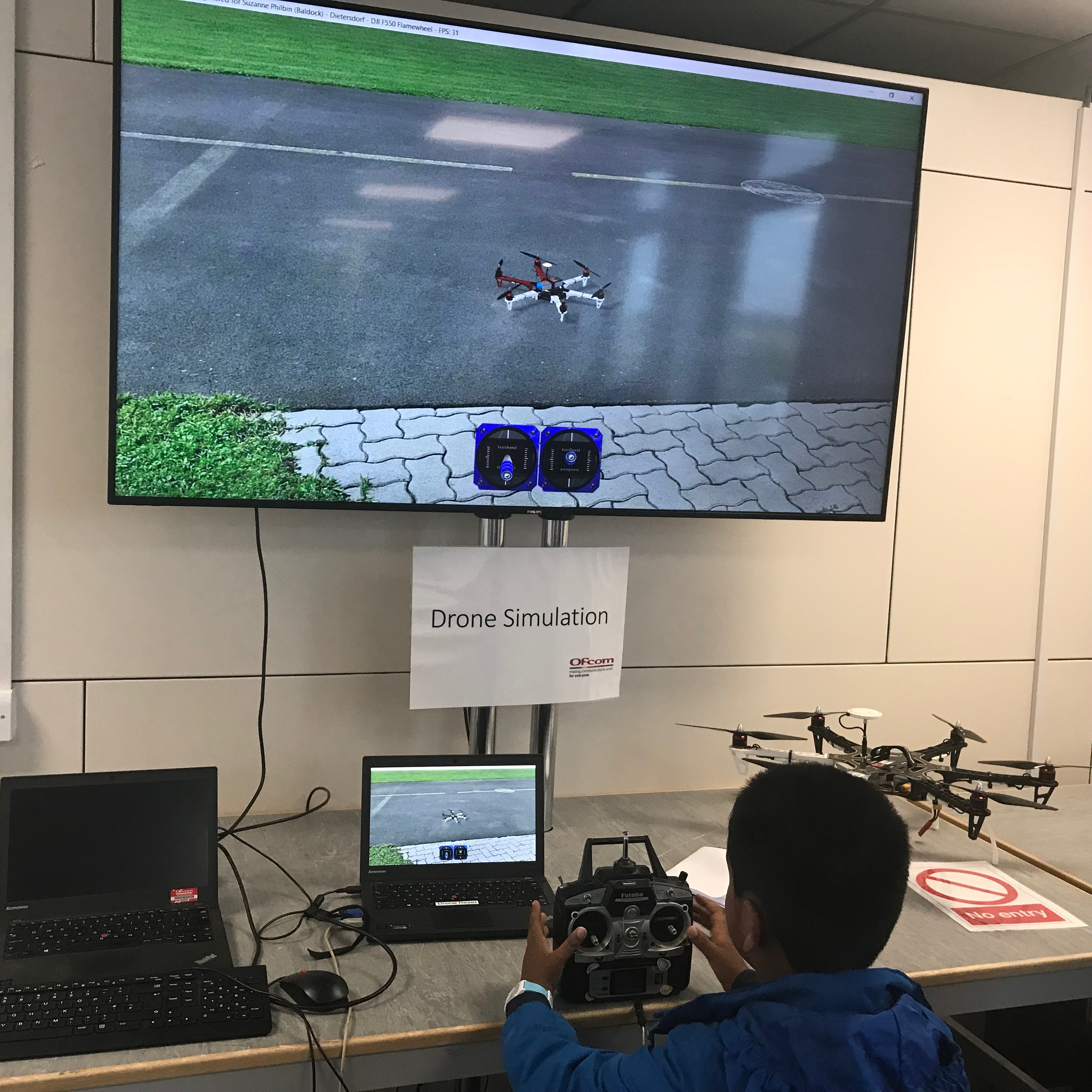 A child gets to grips with a drone simulation