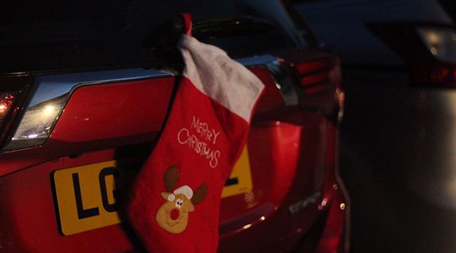 Christmas stocking on a car