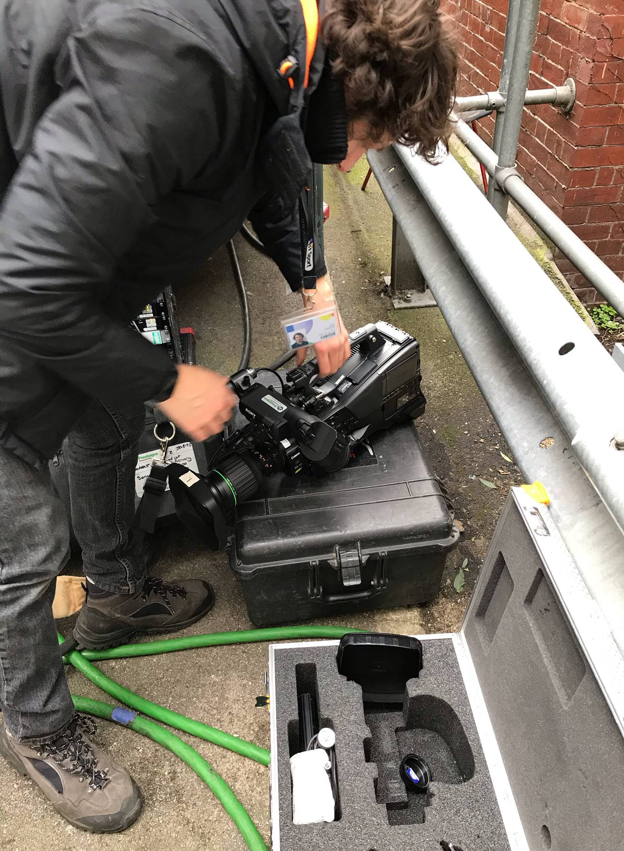 Man unpacking camera equipment