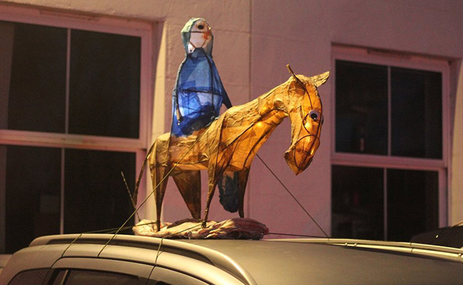 Donkey and Mary on the roof of a car
